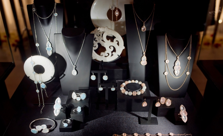 """Living dreams together"" jewelry display set with pieces made from silver, gold and precious, delicate stones."