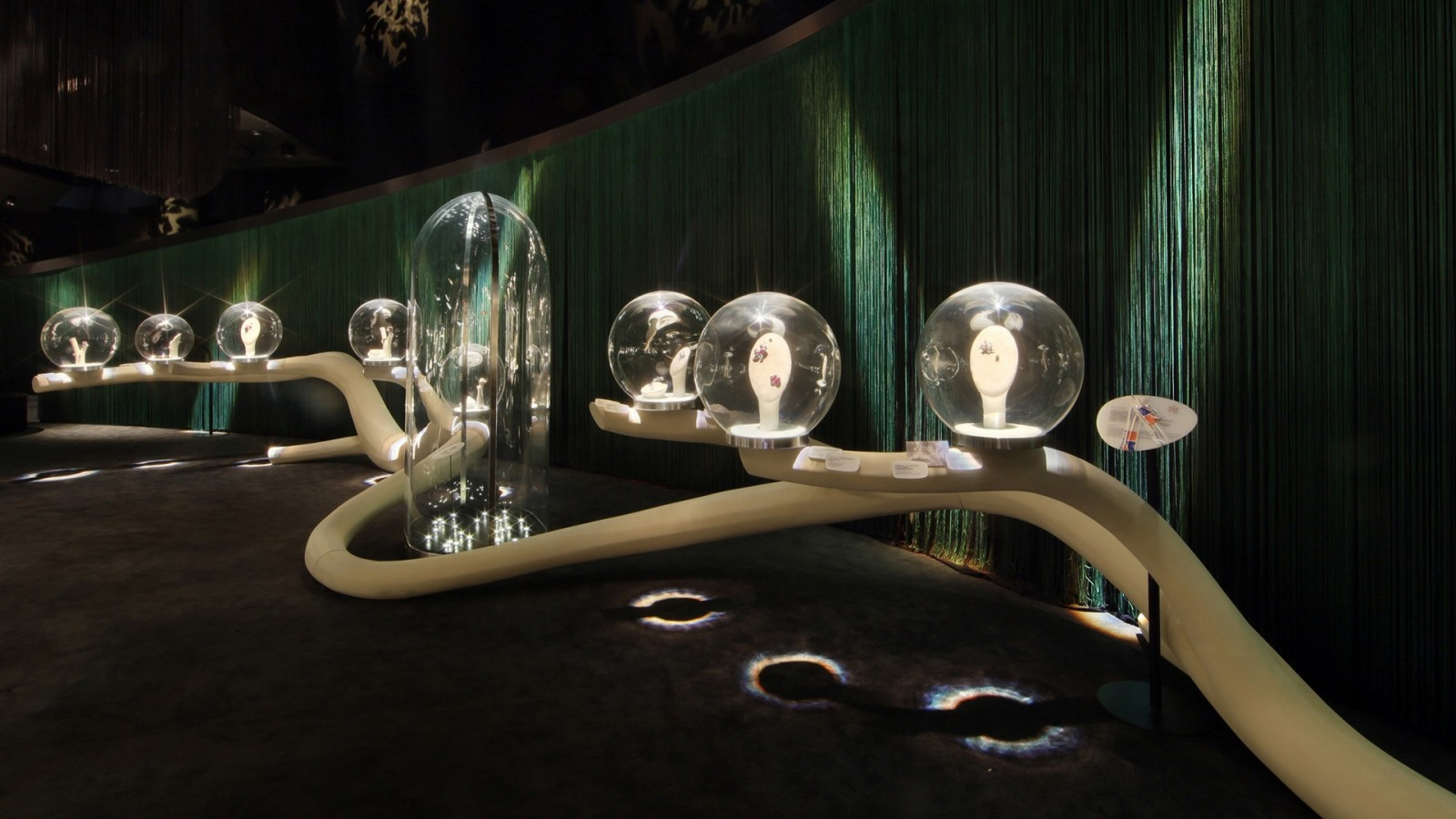 An exhibit by Van Cleef and Arpels, using unique glass bubbles to display the jewelry inside them.