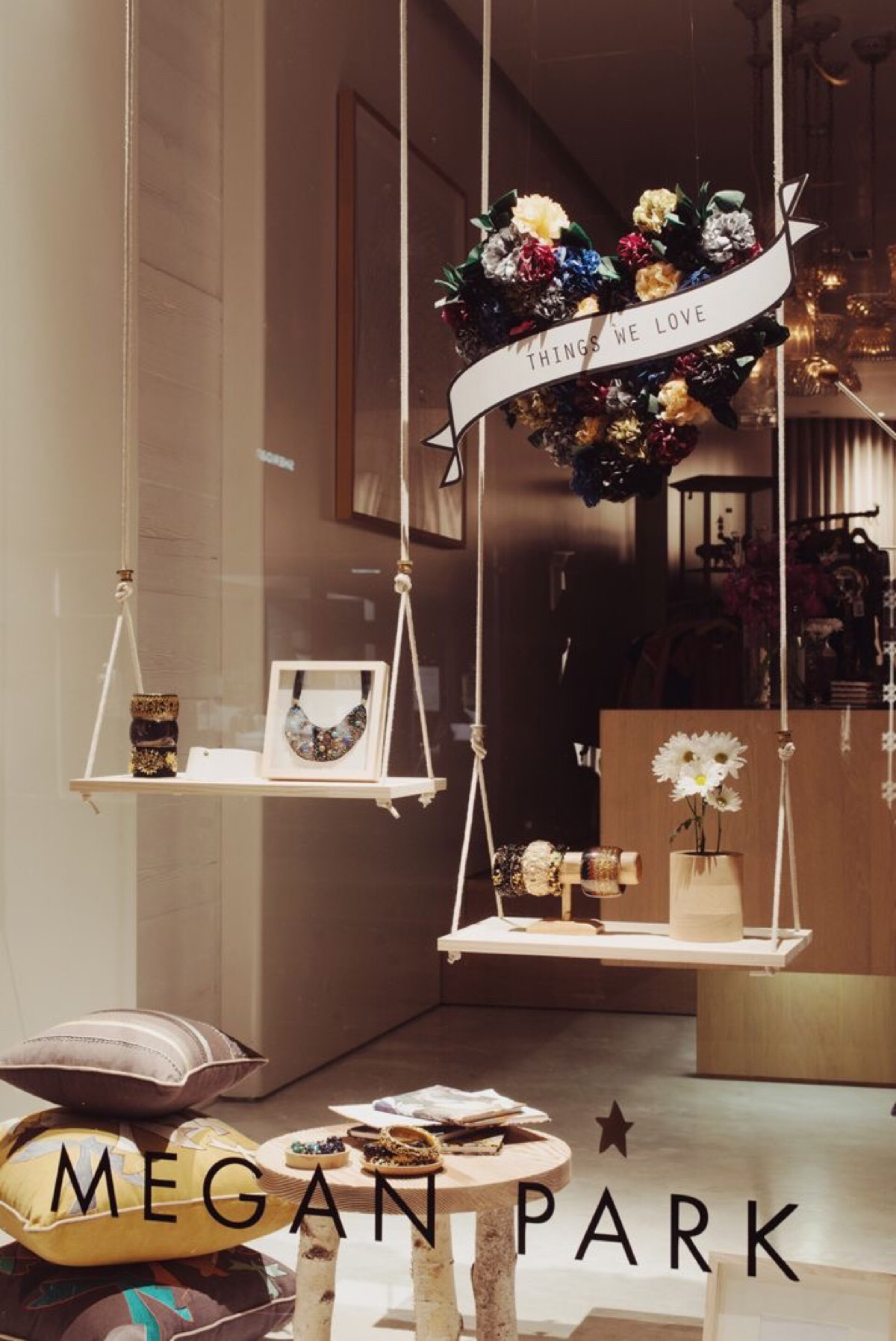 Dreamy ideas for jewelry display using swings instead of stands, and placing the jewelry in a discrete, fun way on them.