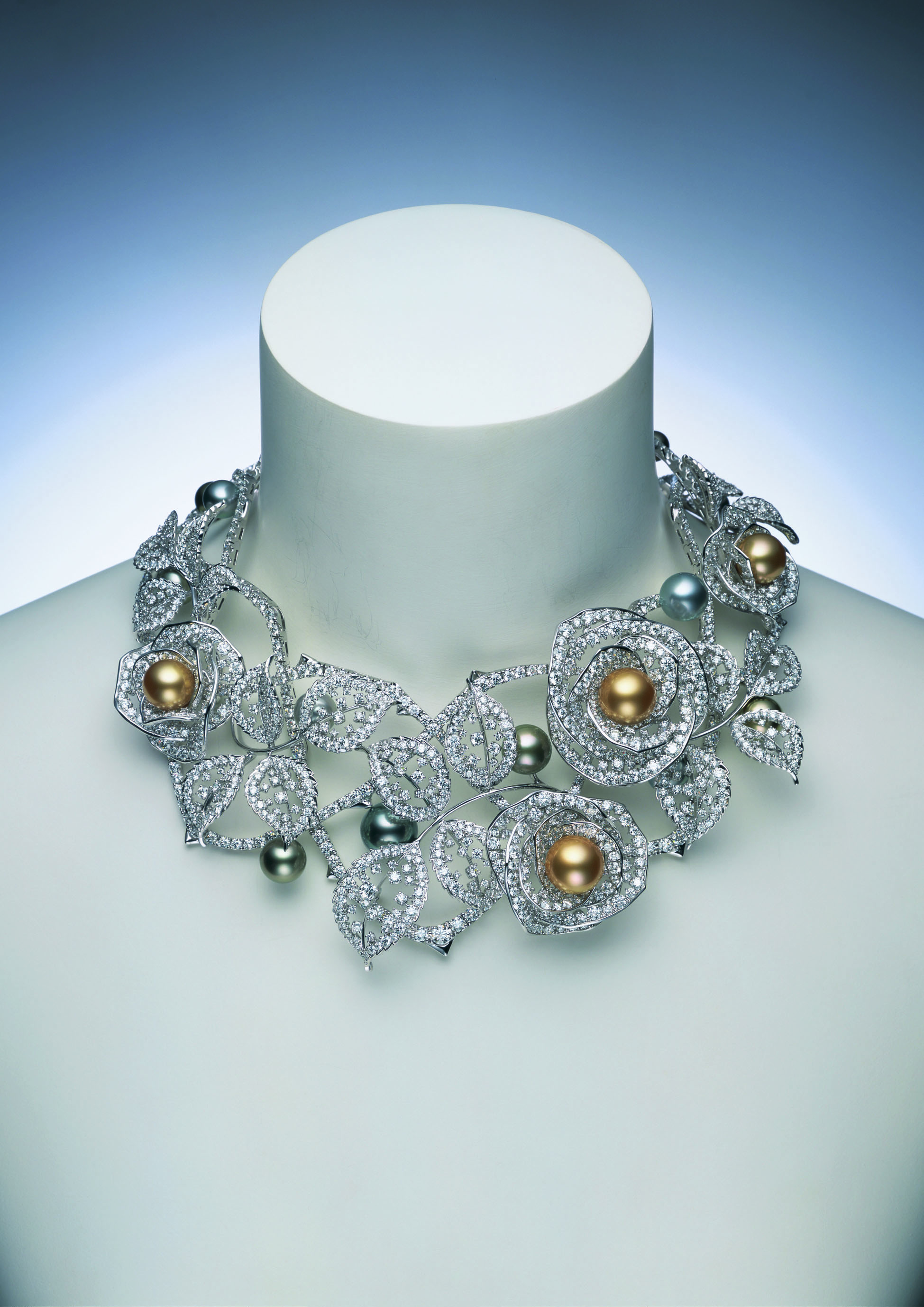Stunning neck piece from Mikimoto Pearl with small encrusted diamonds and colored pearls.