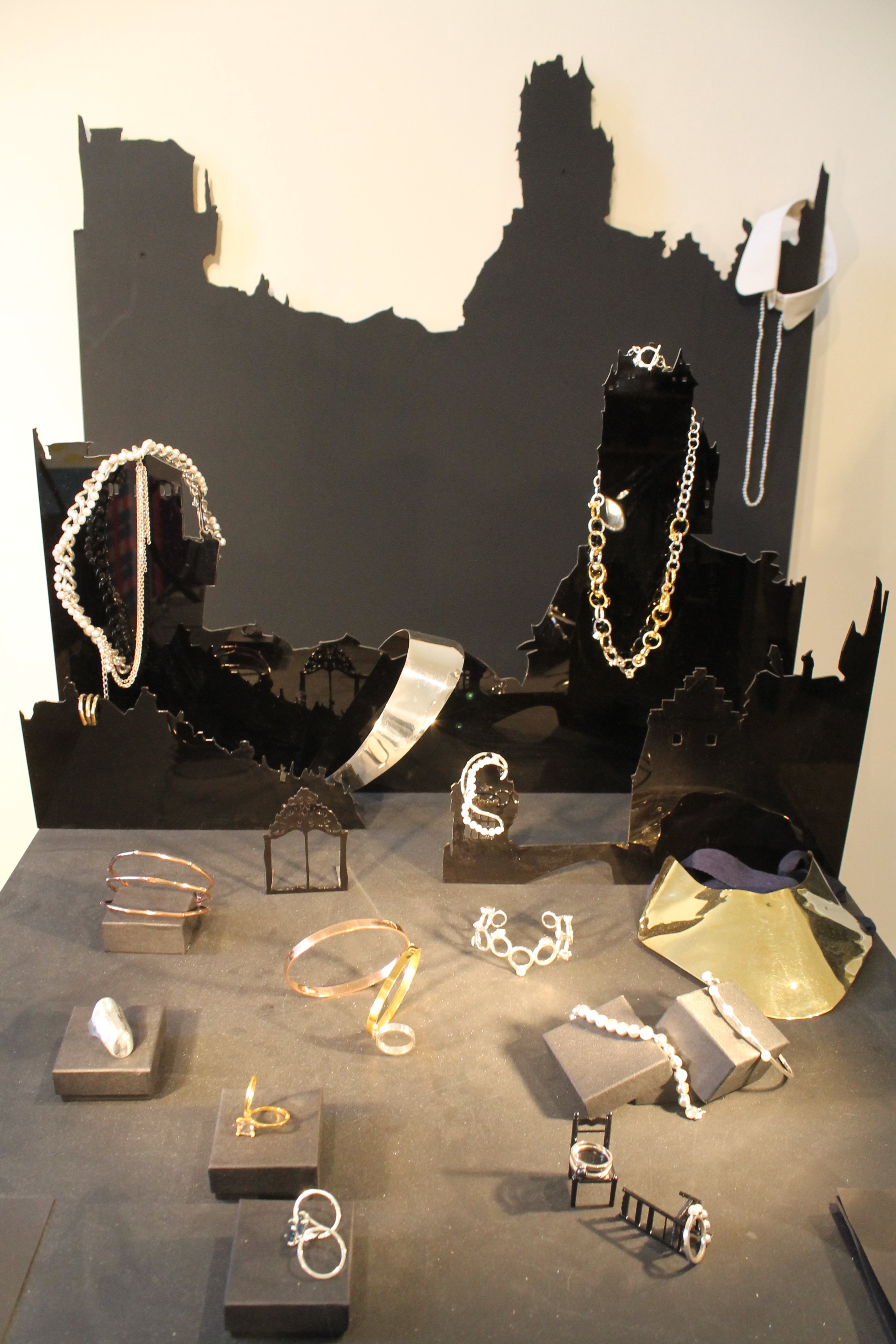 Interesting jewelry display setting resembling shadows of cities for modern minimalist jewelry.