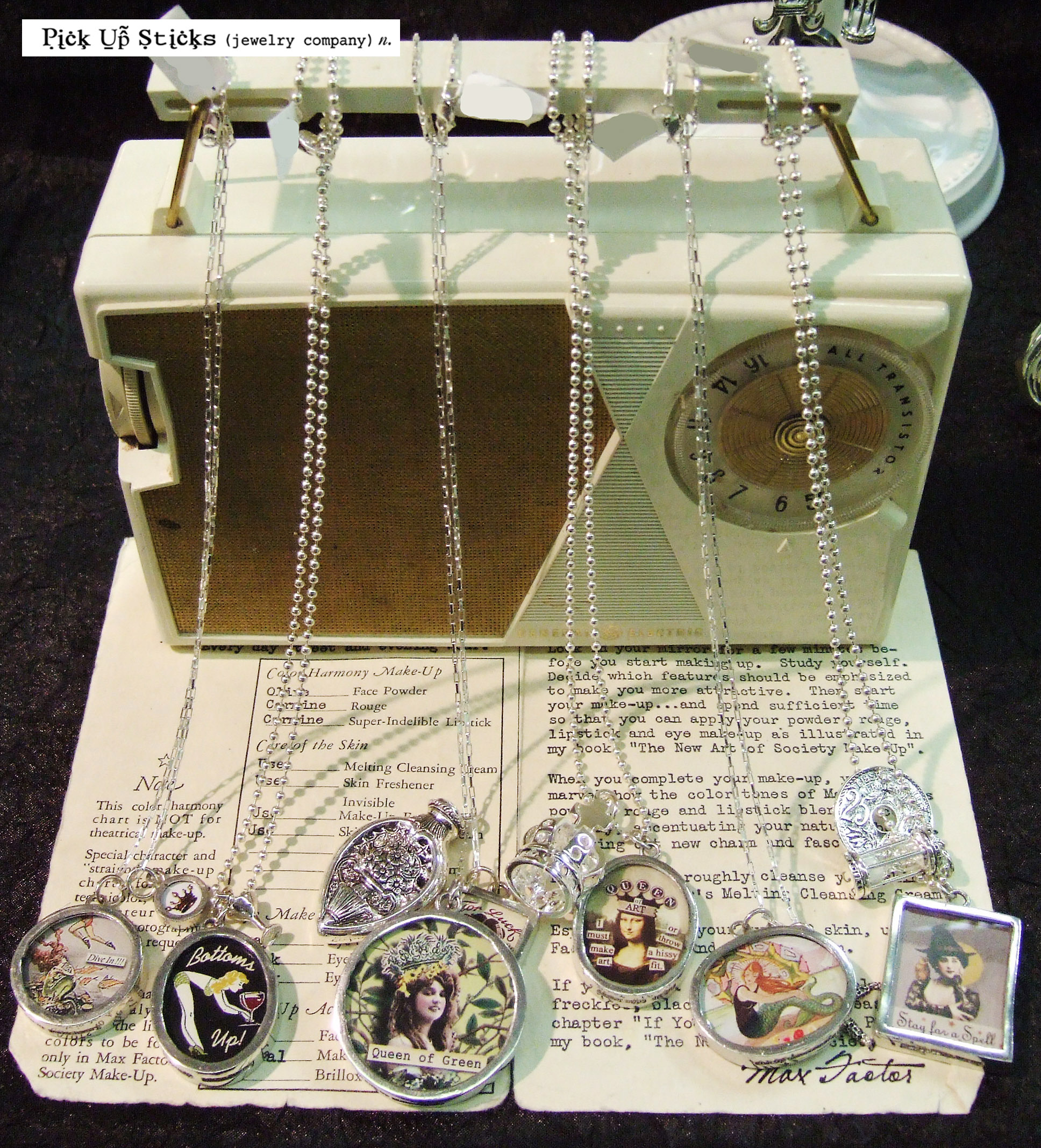 Jewelry display setting by Pick Up Sticks for a retail display contest. Ideas to display vintage retro necklaces.
