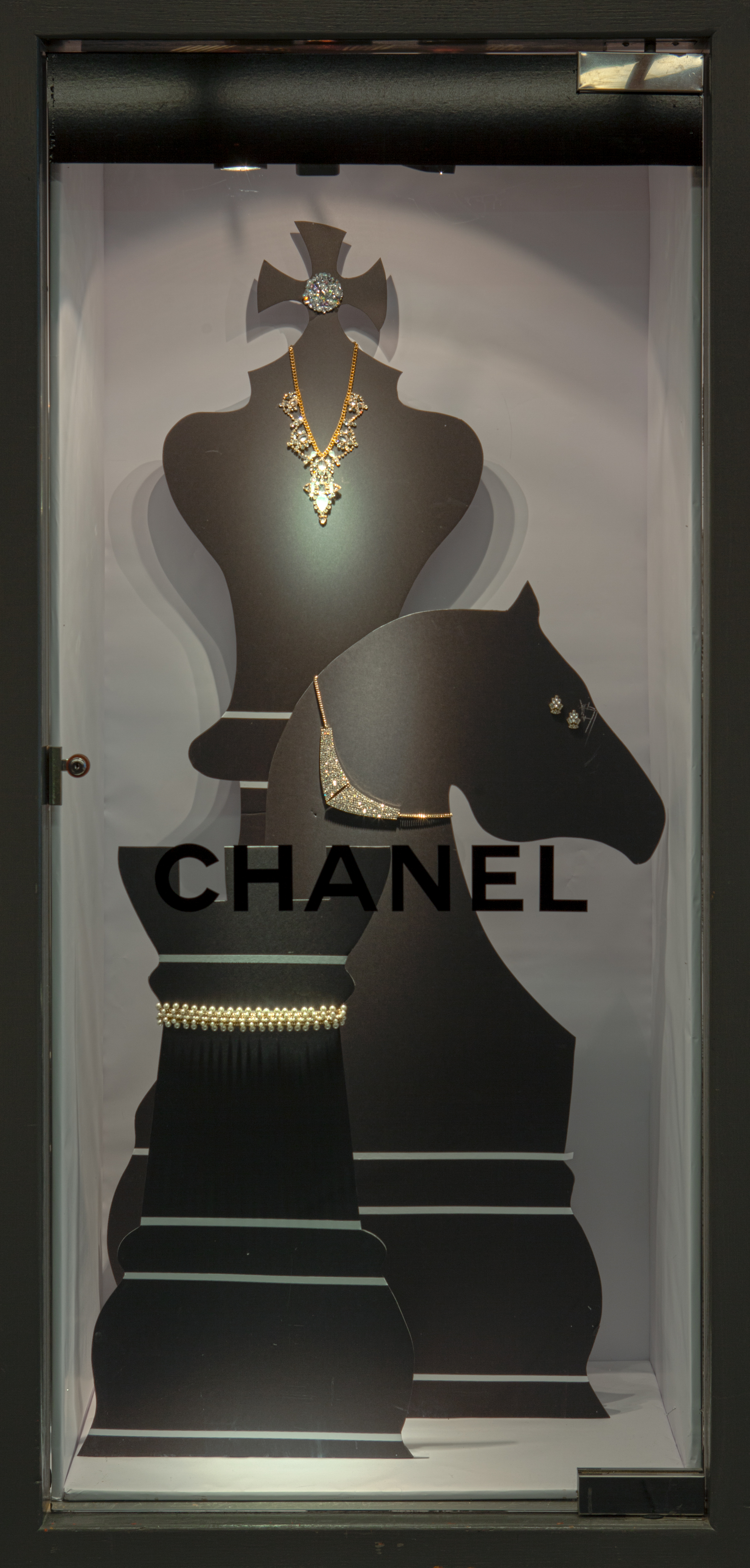 Chanel used chess pieces to display their jewelry, because creativity has no limit when it comes to jewelry display ideas.