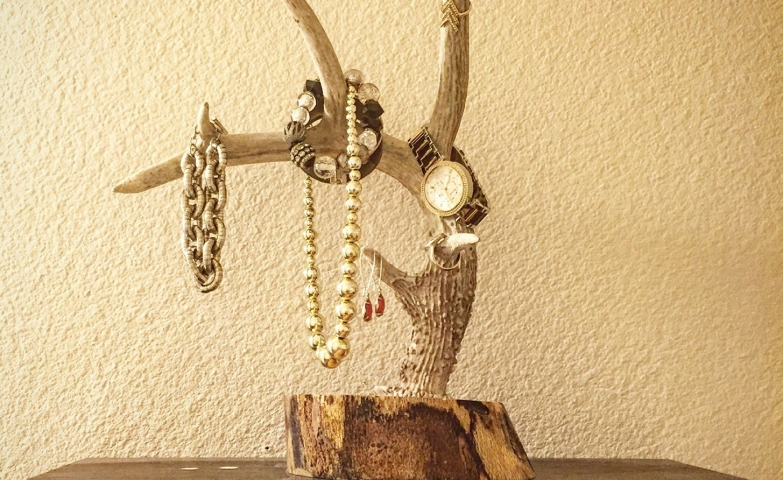 Rustic jewelry display ideas with wooden branches and base, for hanging different jewels.