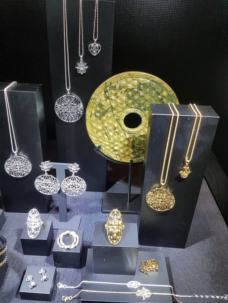Spring collection and jewelry display from Thomas Sabo. Stunning gold and silver pieces hanged and placed on black and grey stands.