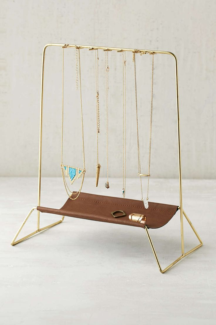 Interesting stand with double use as a necklace hanger and a rings holder, for stylish jewelry display ideas.