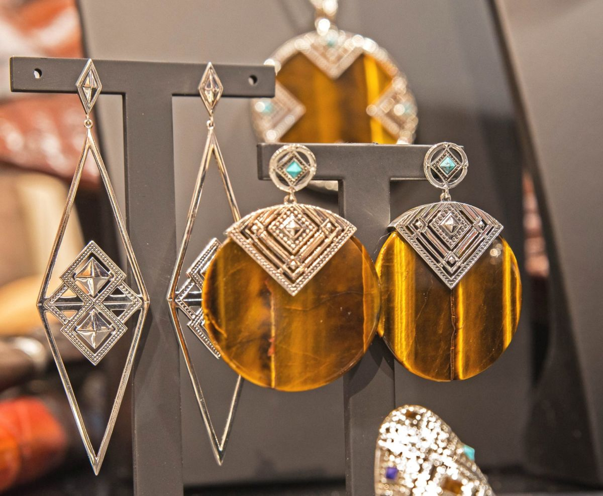 "Close-up on earrings from the Thomas Sabo ethnic inspired jewelry collection. Small ""T"" shaped earring hangers used for the jewelry display setting."