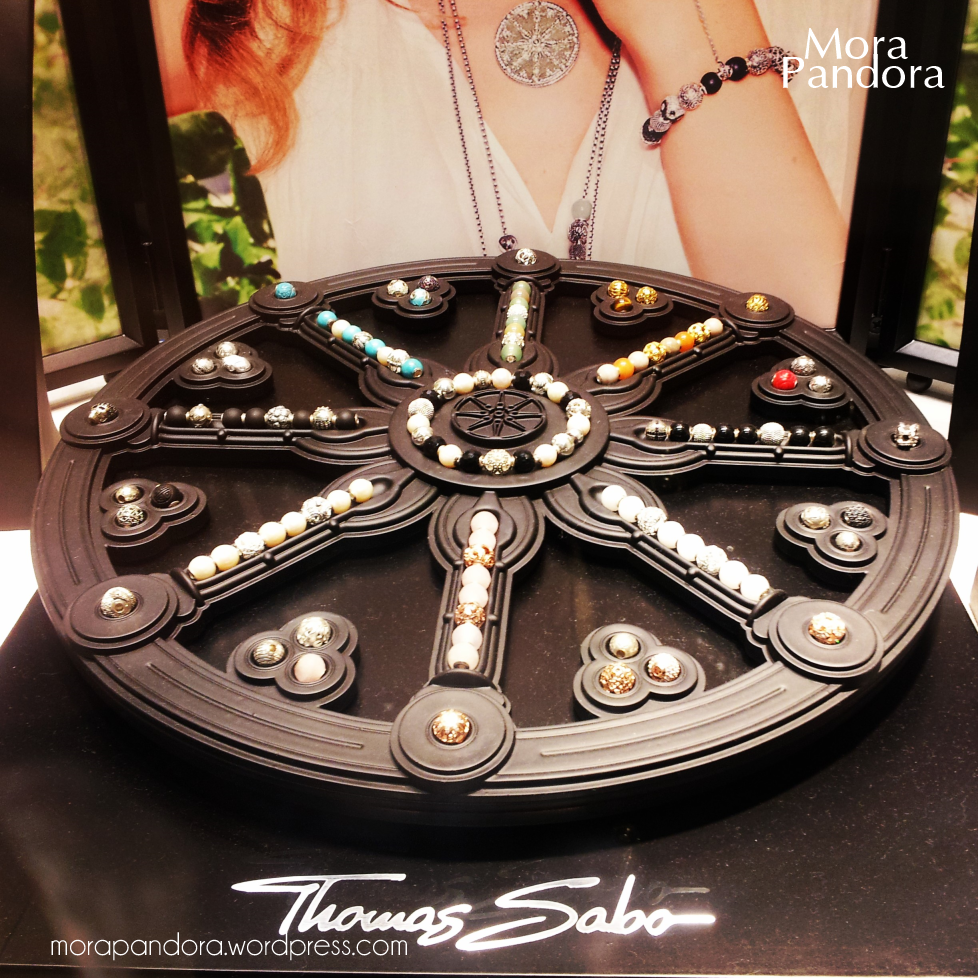 The wheel of Karma with many colorful beads, the jewelry work and art of Thomas Sabo and definitely one of the most original jewelry display ideas.