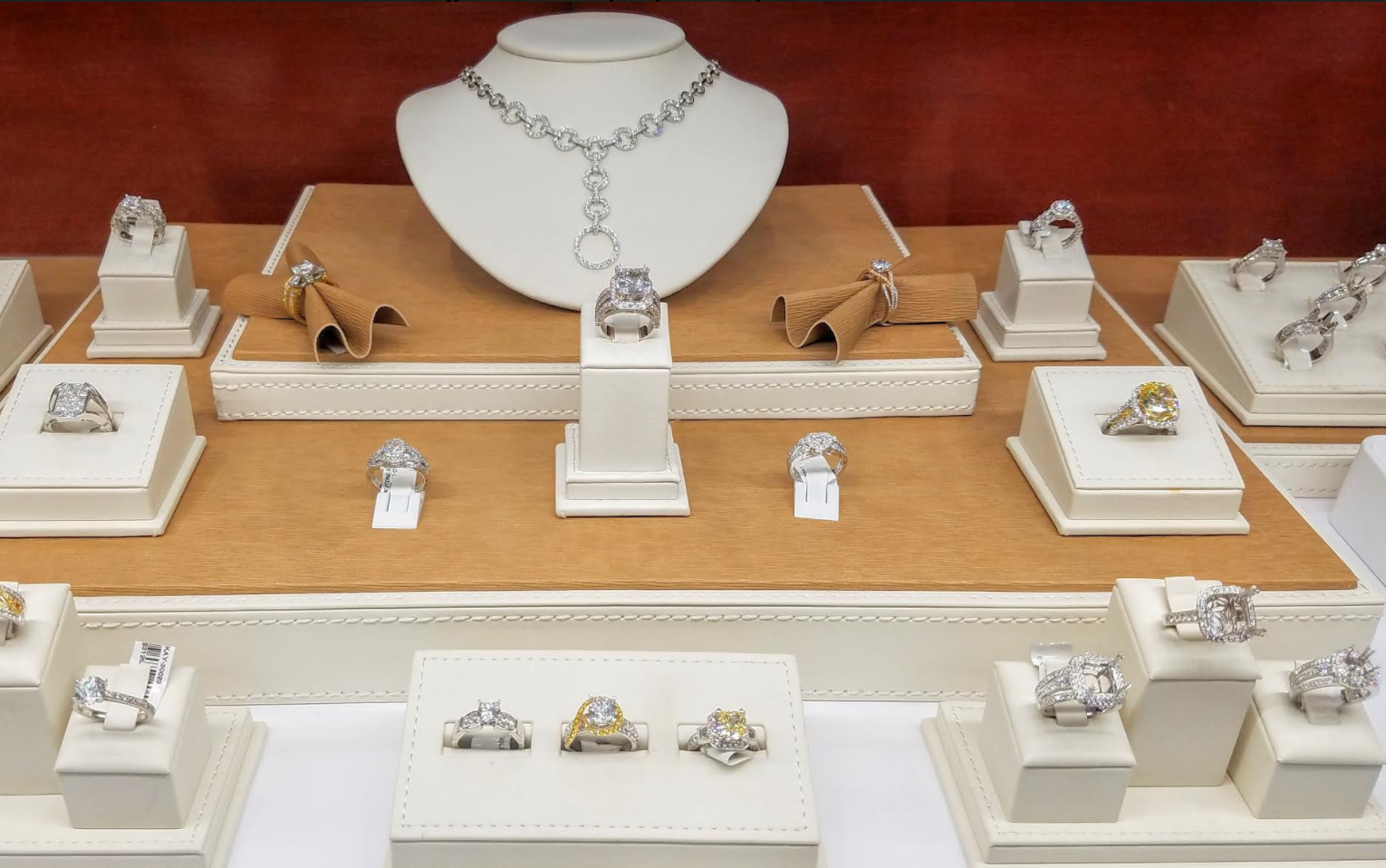 Jewelry display for what are clearly some very expensive diamond jewelry pieces, especially many diamond rings by Madani.