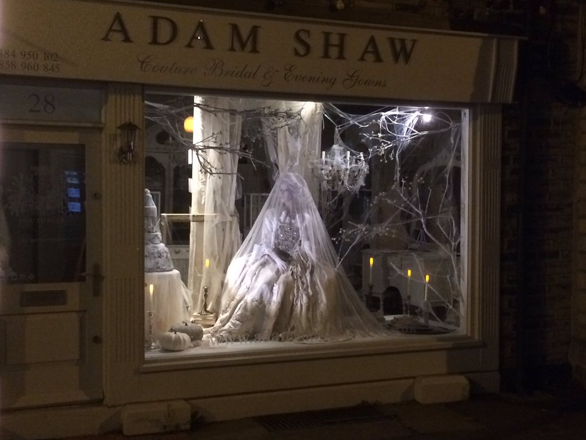 At Adam Shaw, the Halloween window display goes all silver/white with a bride mannequin covered totally with a veil, looking mysterious.