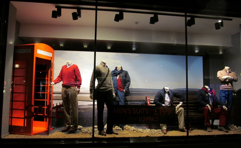 At Austin Reed shop, autumn is coming with scarfs and a sunset background, that might represent the season.That's how this shop window display looks.