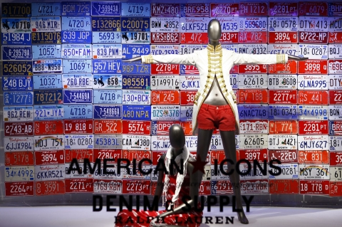 I bet you have never seen so many patriotic license plates near red and white patriotic denim in a window display.