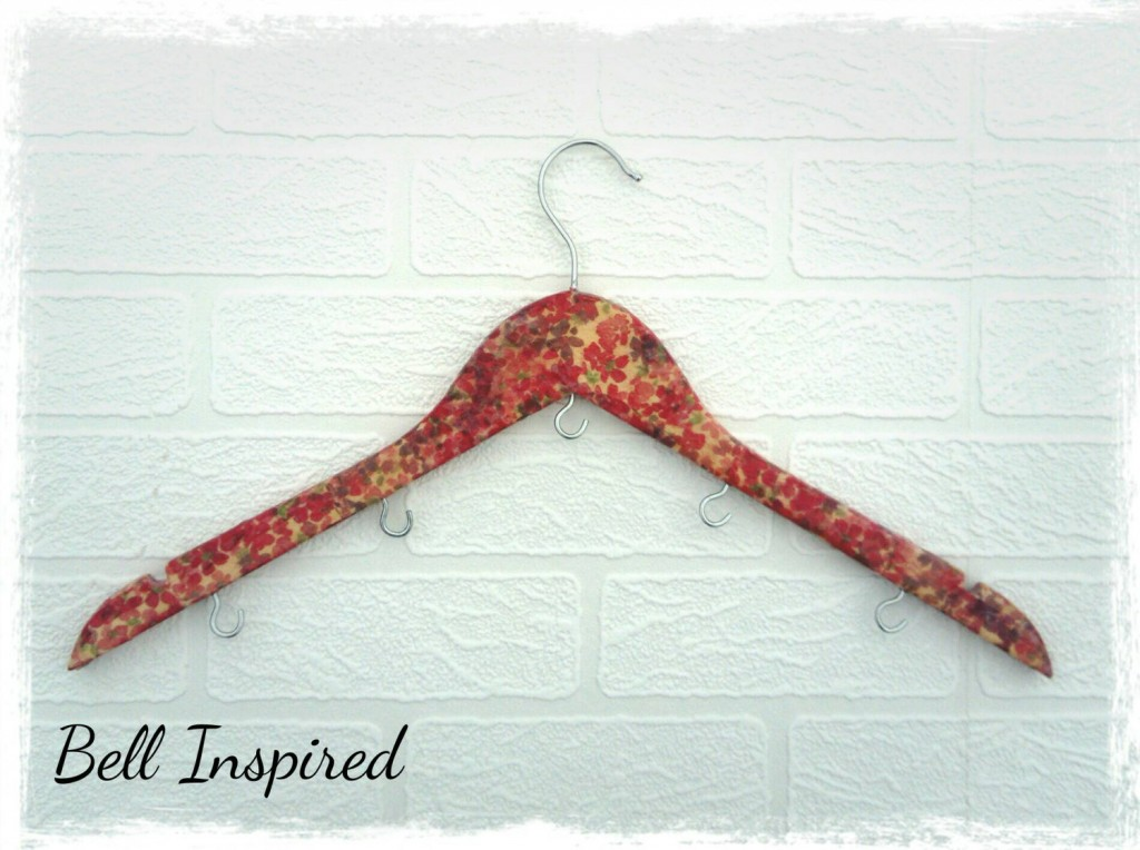 This unique hanger can be used in a creative way as a jewelry necklace holder and also as a pretty bedroom decor.
