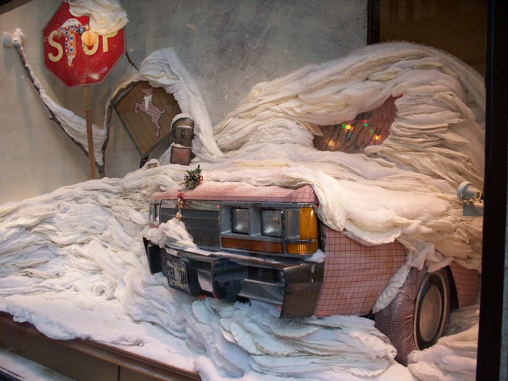 Also from Anthropologie window display, this design with the stop sign and the car full of snow created from white sheets and cotton wool is out of the box.