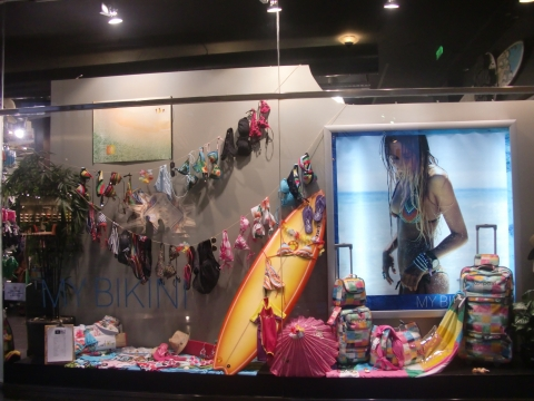 Summer at its best in this window display decorated with swimsuits and beach stuff.