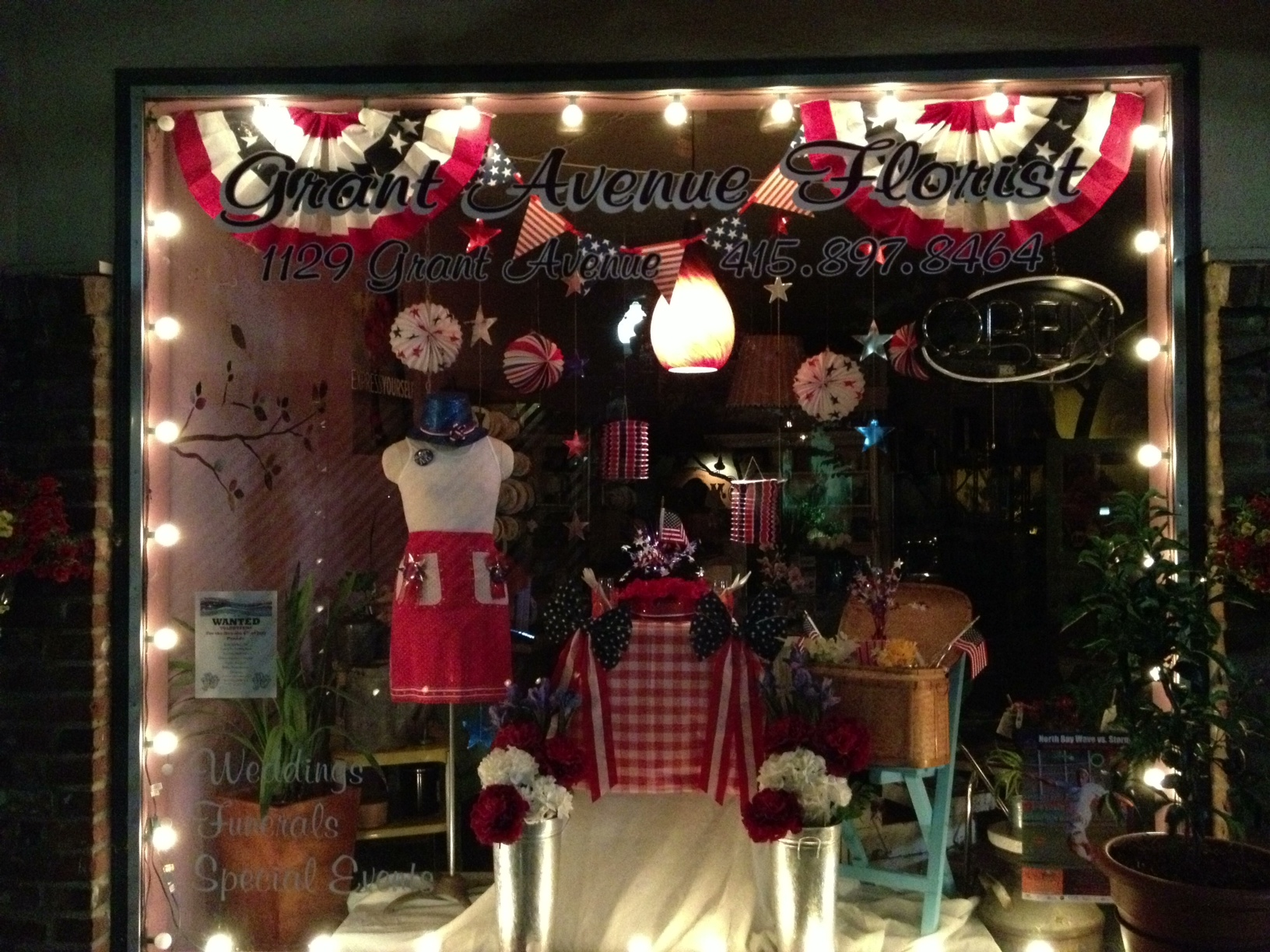 Representative 4th of july flag-scarf and a teddy bear are the main elements that blooms this window display.