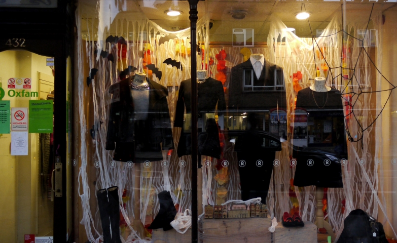 This is a store which put in the window display black clothes for Halloween, ravens, and pumpkins.