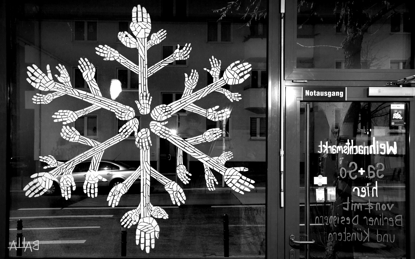 Always standing out, Berlin has a different way to decorate the winter window display, as they painted a snowflake composed from many hands.