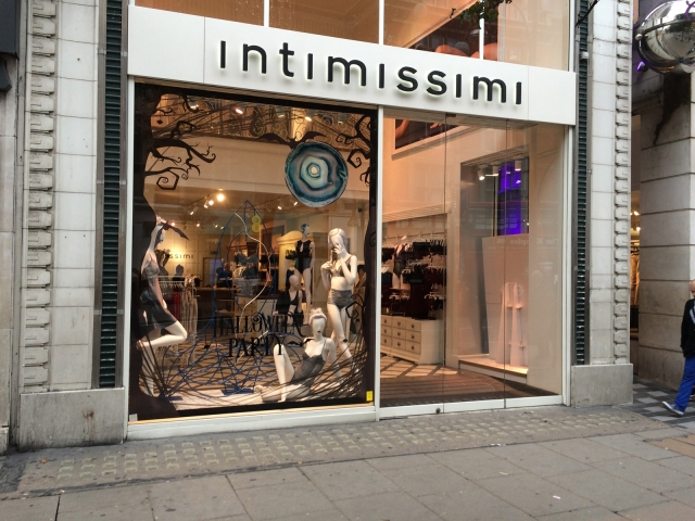 A black party for Halloween, full of print on the inside of the window display for Intimissimi store.