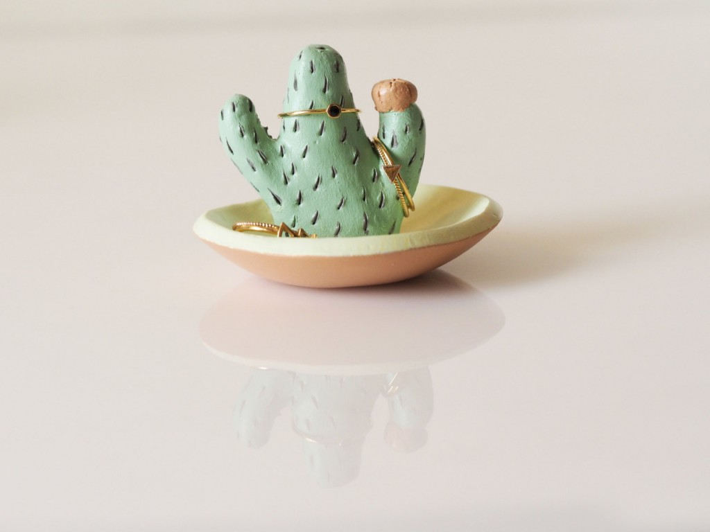 A creative cactus ring holder with a jewelry dish painted in pastel colors.