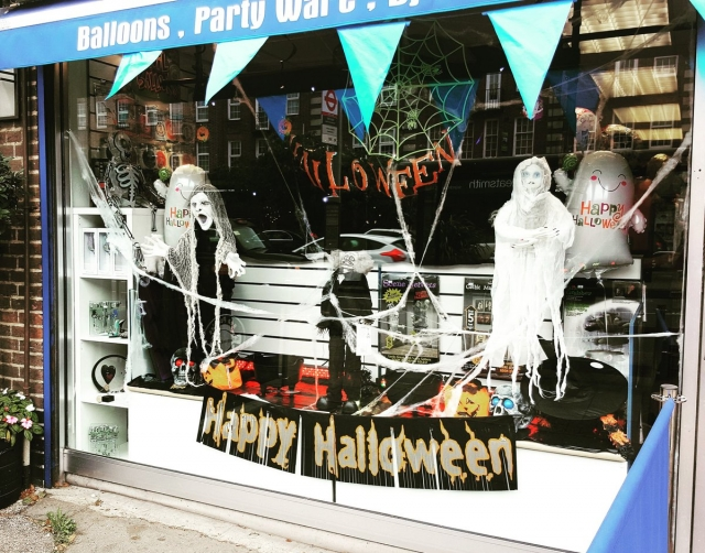 This window display is marking Halloween with happy ghosts, blue, white and black colors.