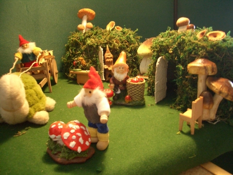 Cestina's dolls house decorated their autumn window display with smurfs and shrooms.