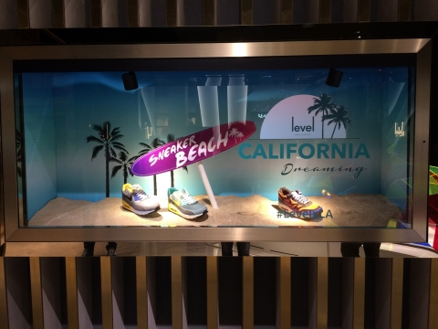 This store creates an almost real California Dreaming type of window display for its summer sneakers.