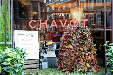To decorate the window display in a stylish way like Chavot, you can take a mannequin and put on a dress made from autumn flowers.