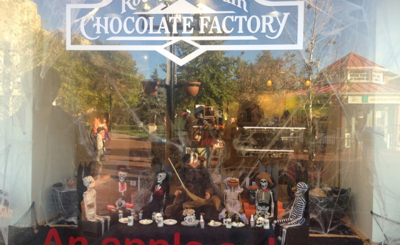"This is the biggest irony ever seen in a chocolate store window display: little skeletons having dinner, and a message on the window which says "" An apple a day…"". I would add ""keeps the Halloween away""."