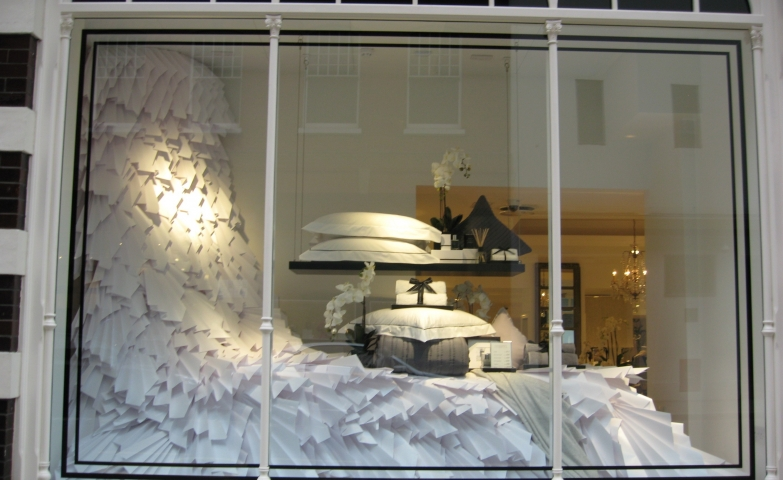 Christian Louboutin made everything in this window display looking so fragile and elegant with those perfect pillows and arrangement.