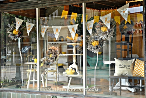 Such an amazing design for summer window display, with huge paper flowers and cozy painted furniture.