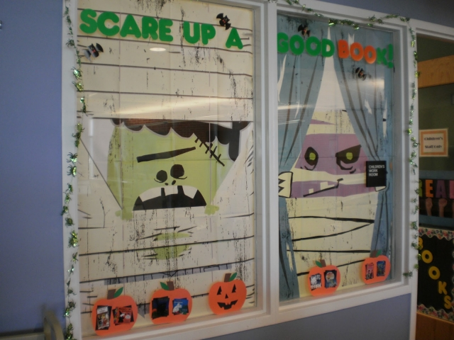 This is a creative Halloween window display with a cute message and not so scary painted or stick cartoons all over the window.