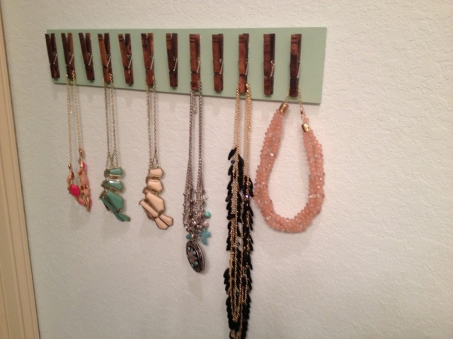 An organized way to have a jewelry necklace holder, is to stick some clothespin on a wood chop. This is also creative and easy.