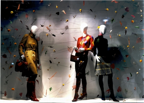 """This window display has some little colored things that are looking like origami birds, and the patterns on the clothes are """"yelling"""" autumn."""