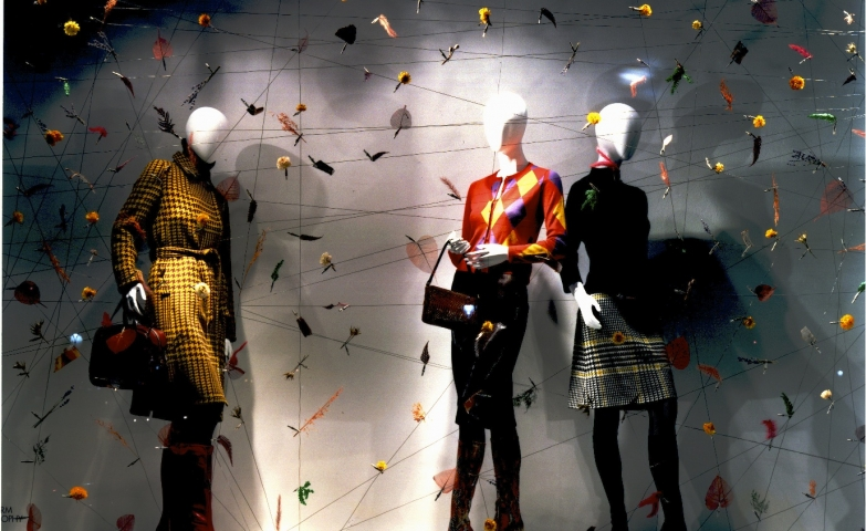 "This window display has some little colored things that are looking like origami birds, and the patterns on the clothes are ""yelling"" autumn."