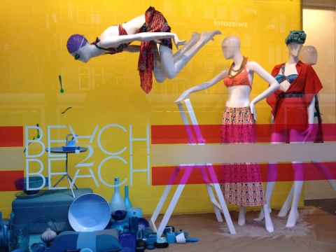 A creative way to make a spot look like water and many colors for this summer window display.