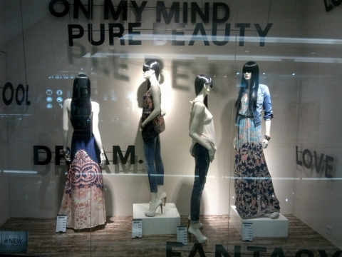 """The autumn window display from Stradivarius is decorated with some words like """"dream"""", """"cool"""", """"fantasy""""."""