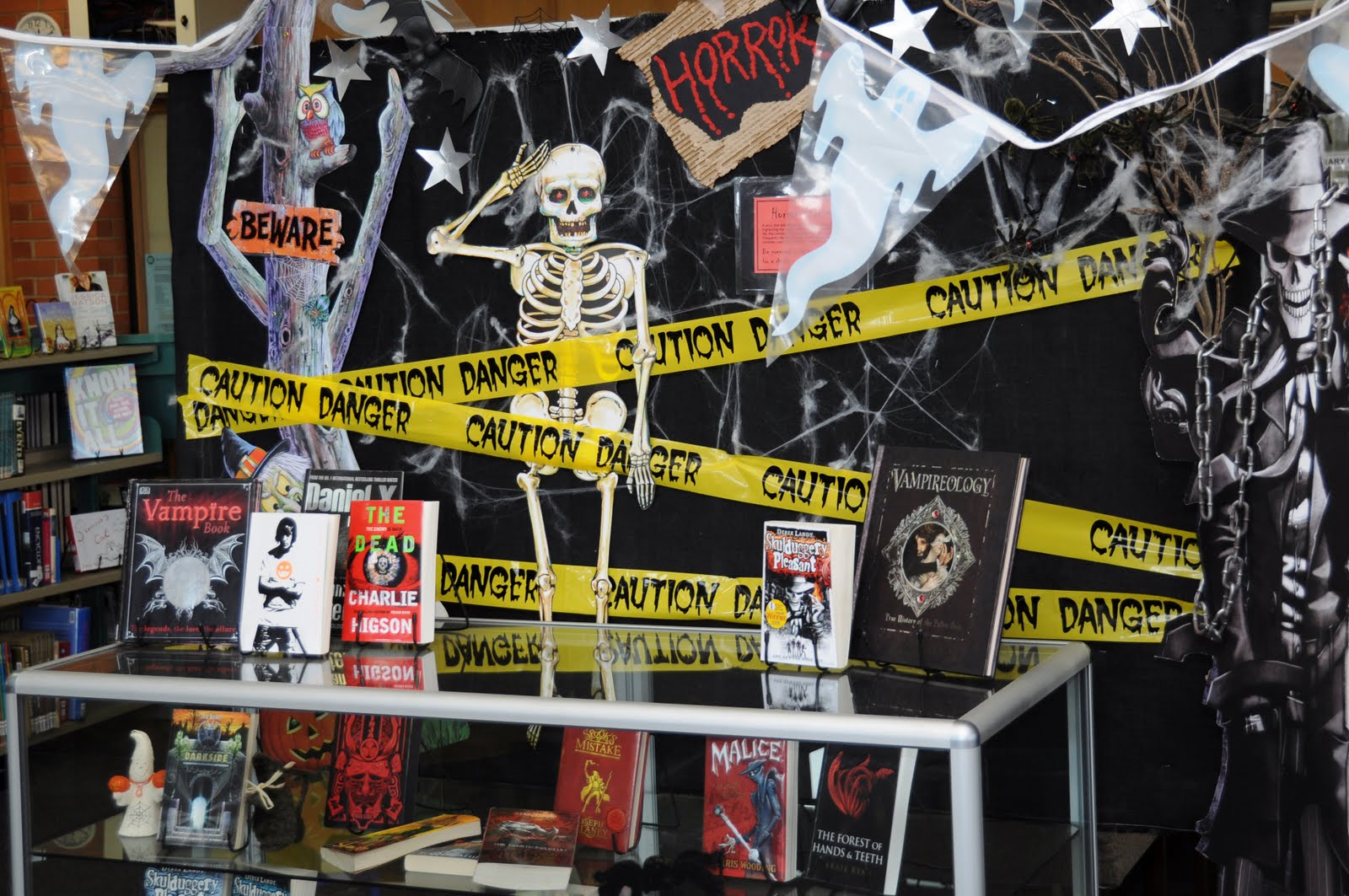 Another decoration for Halloween, but inside the store, with a black and yellow caution band and a scary skeleton. I bet the window display it's looking awesome too.