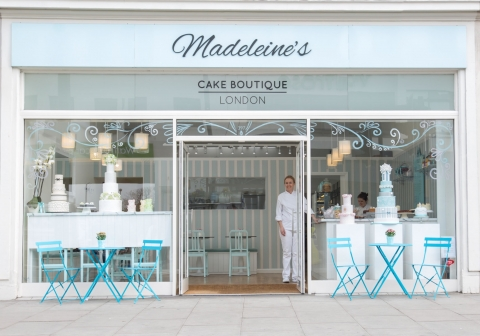 A cake boutique with an elegant presence needs only a simple summer window display like in this image.