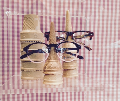Eyewear shop created this summer window display in a creative way with glasses and pastry horns
