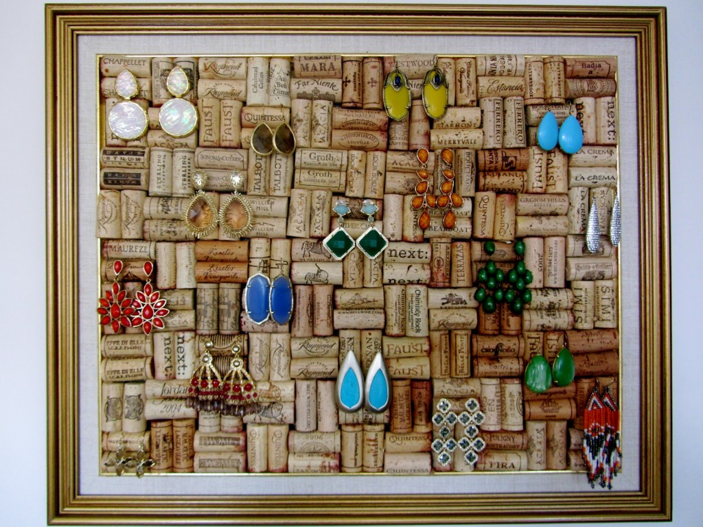 You can have a creative jewelry earring holder by putting some cork plugs together into a picture frame, painted with golden colour.