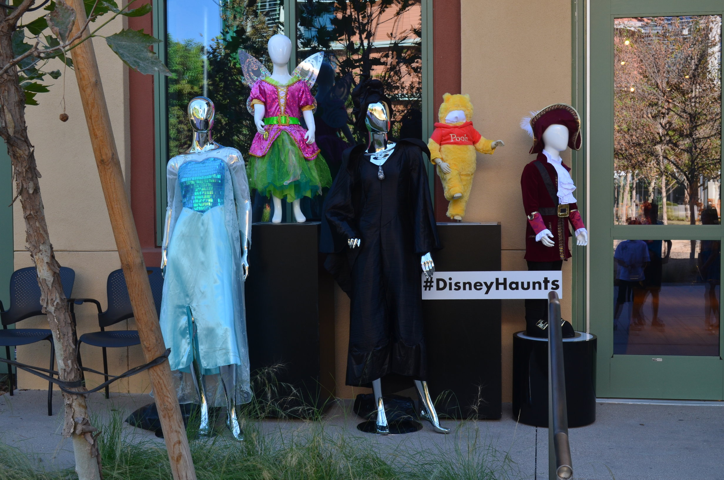 Outside the window display are placed the most popular Disney costumes for Halloween: Winnie the Pooh or Tinkerbell for example.