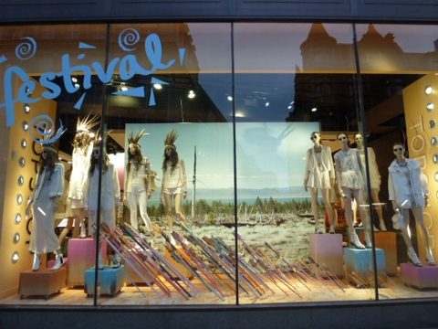 A theme for summer window display that includes white clothes and a festival background.