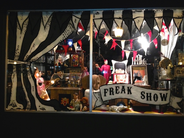 This store has a story for Halloween with a circus, looking like a freak show, scary, best for Halloween window display.
