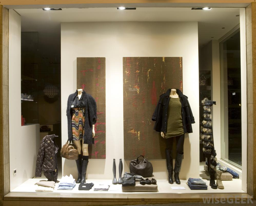 This window display has a background in earthen colors and also coats and boots for the autumn season.