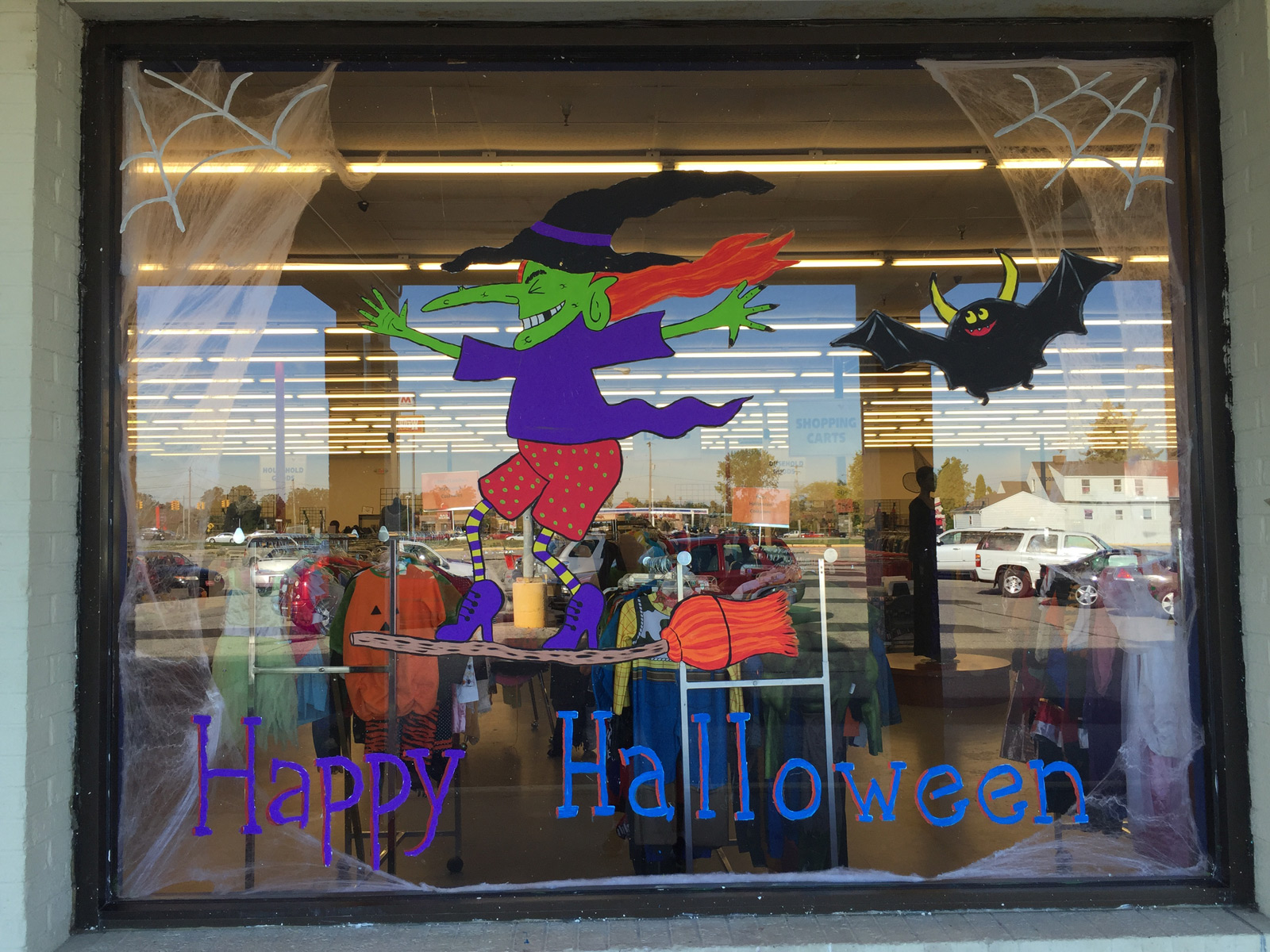What a funny type of a Halloween window display, with a comic witch practicing balance on a broomstick.