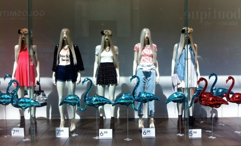 For some, this is how a high summer fashion has to be: Flamingos, lightened hair, clear clothes all in a window display.
