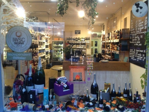 You can see between the bottles some fallen leaves. This store made it simple for the autumn window display.
