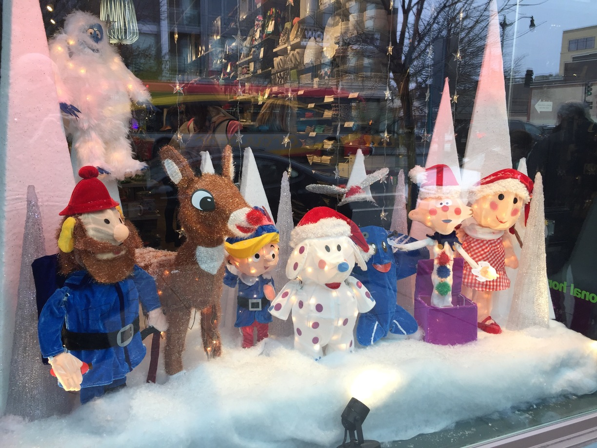 Happy puppets in this winter window display, describing a few characters even a reindeer.