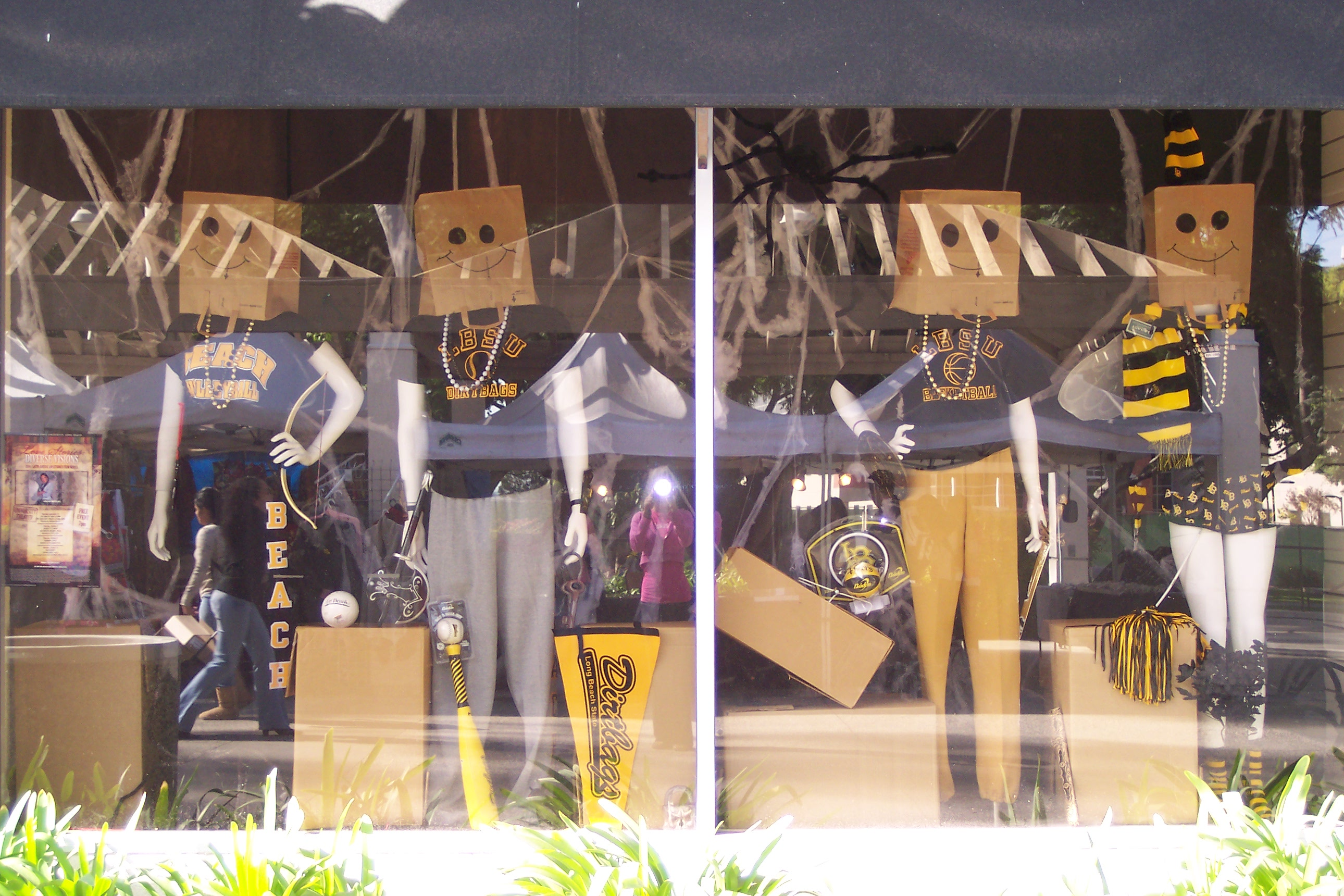 Even mannequins from window displays are getting ready for Halloween with happy masks made of paper bags.